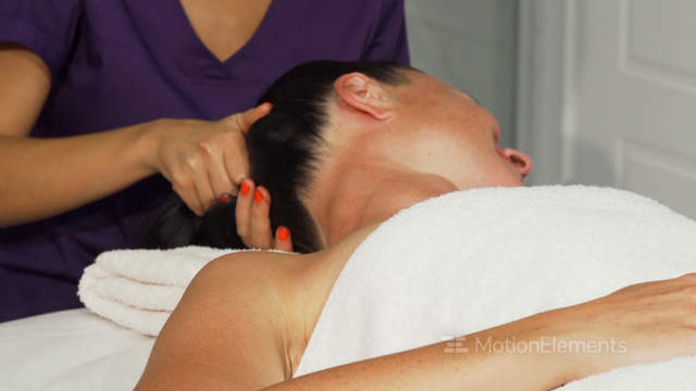Young Happy Female Therapist Giving Massage To A Client Stock Video Footage 12225325